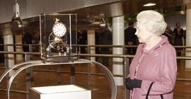 Her Majesty Queen Elizabeth receives a Dent Great Wheel Skeleton clock