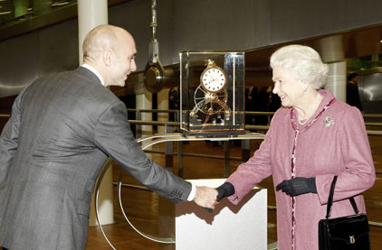 The Queen receives her Great Wheel Skeleton clock from Dent
